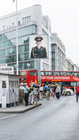 visitors and sightseeing bus at checkpoint charlie