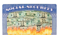 Many US dollar bills on fire inside Social Security framework as concept for funding crisis