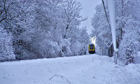 train in snow forest