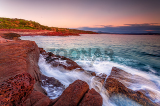 Early morning on the rich red rocky coast of Eden