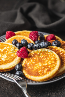 Sweet homemade pancakes with blueberries and raspberries