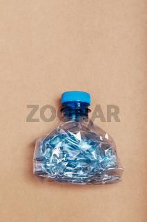 Squashed empty plastic bottle