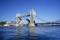 Tower Bridge and the River Thames with the Drawbridge raised. Tower Bridge is a combined bascule and