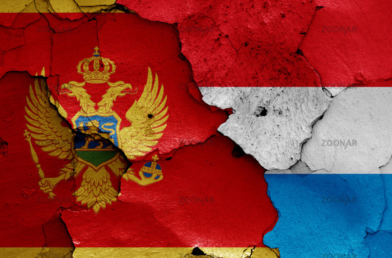 flags of Montenegro and Luxembourg painted on cracked wall