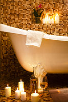 Interior of bathroom in retro style with candles burning