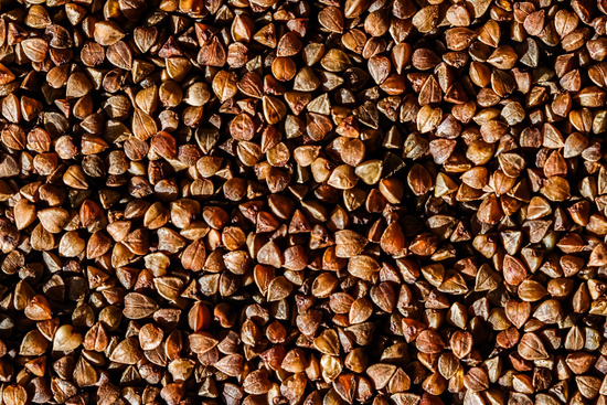 Buckwheat grain closeup, food texture and cook book background
