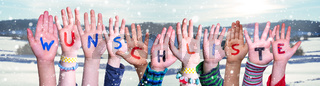 Children Hands Building Word Wunschliste Means Wishlist, Snowy Winter Background