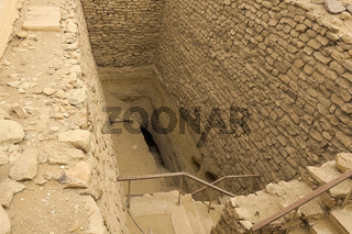 Underground entrance near the pyramid. Ancient buildings.