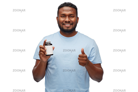african man with medicine showing thumbs up