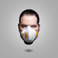 Elevated head of a man wearing a FFP3 respiratory mask. Corona virus sickness and burnout symbol con