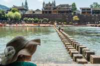 Chinese woman and stepping stones in Fenghuang