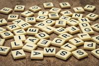 alphabet in random letter tiles