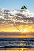 Kite surfing on the sea in the sunset