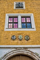 Annaburg, Germany - 07/17/2019 - Window with coat of arms on the rear lock