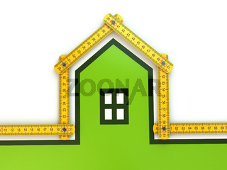 House from yard stick on white background .
