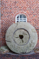 Old Millstone Standing at a Windmill in East Frisia, Germany