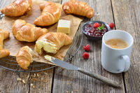 Small fast breakfast with croissants and coffee