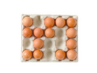 Fresh brown eggs in paper carton