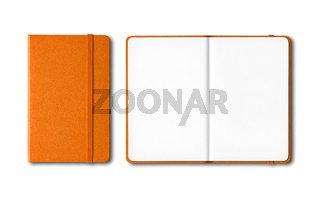 Orange closed and open notebooks isolated on white