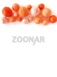 Orange balls of yarn isolated on white background.