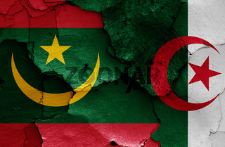 flags of Mauritania and Algeria painted on cracked wall