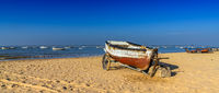 old wooden fishing boats on the beach at Sanlucar de Barrameda