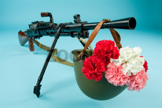Machine Gun And Flowers