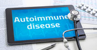 The word Autoimmune disease on the display of a tablet