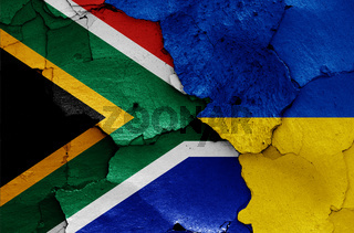 flags of South Africa and Ukraine painted on cracked wall