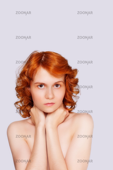 Young red-headed beauty.background
