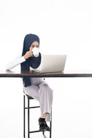 Muslim girl using laptop coffee