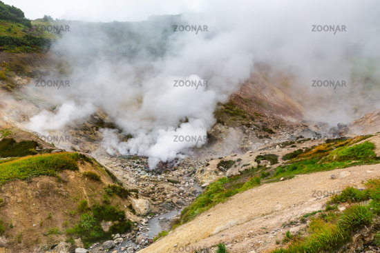 Breathtaking scenery view of volcanic landscape, aggressive hot spring, eruption fumarole, gas-steam