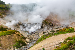 Breathtaking scenery view of volcanic landscape, aggressive hot spring, eruption fumarole, gas-steam activity in crater of active volcano