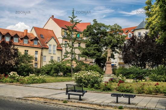 Delitzsch, Germany - June 19, 2019 - small park with a monument by Hermann Schulze Delitzsch