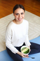 Cheerful woman with healthy food