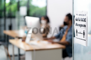 Office reopen with social distance signage