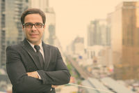 Handsome Persian businessman against view of the city