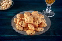 Amaretti, traditional Italian almond cookies, with a glass of Amaretto liqueur