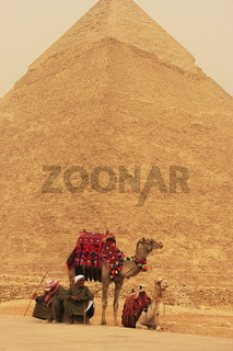 Bedouins resting near Pyramid of Khafre during sand storm, Cairo