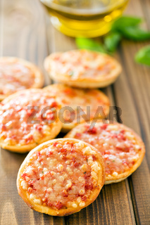 mini pizza on wooden table