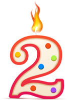 Two years anniversary, 2 number shaped birthday candle with fire on white