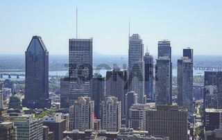 Montreal view from Mount Royal in summer day. All main skyscrapers together with a river behind