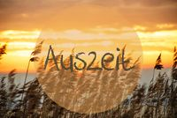 Beach Grass At Sunrise Or Sunset, Text Auszeit Means Downtime