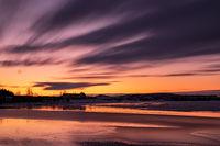Sunset in Heidmork lake, Iceland