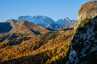 Autumn alpine Dolomites mountain view from Falzarego Pass to Marmolada massif and Glacier.