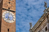 vicenza, italy - 19.03.2019 - old clock on the bell tower at piazza dei signori
