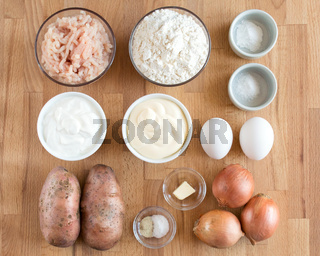 Ingredients for making minced meat and potato pie. Square photo, top view. Knolling