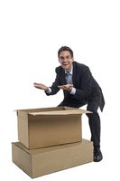 Businessman in front of a box