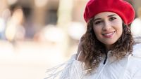 Photo of fashionable girl with red hat, space for title, copy space
