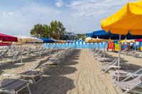 Sun parasols arranged in rows